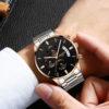 rose gold black dial watch